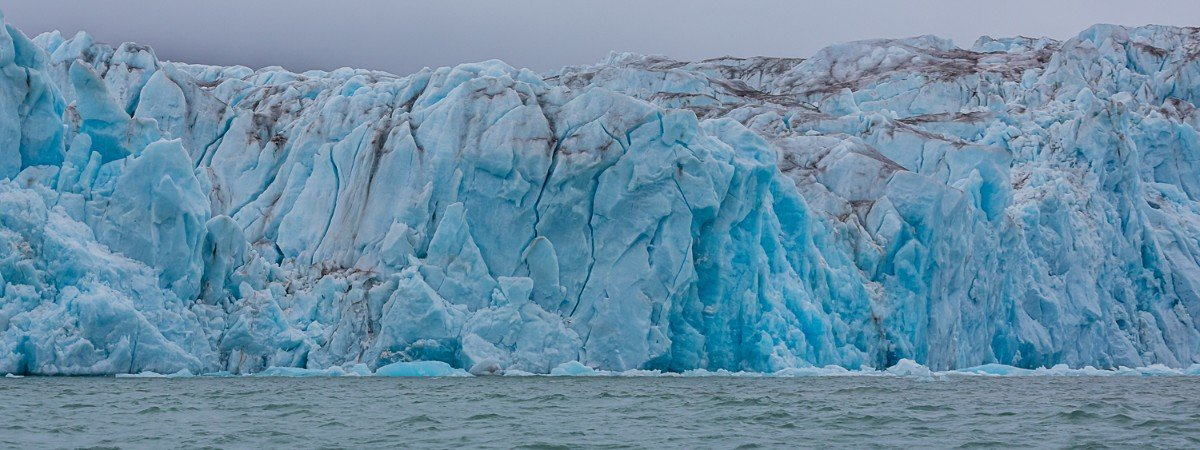 The front of a glacier in Kongsfjorden, Svalbard, seen from the ocean.