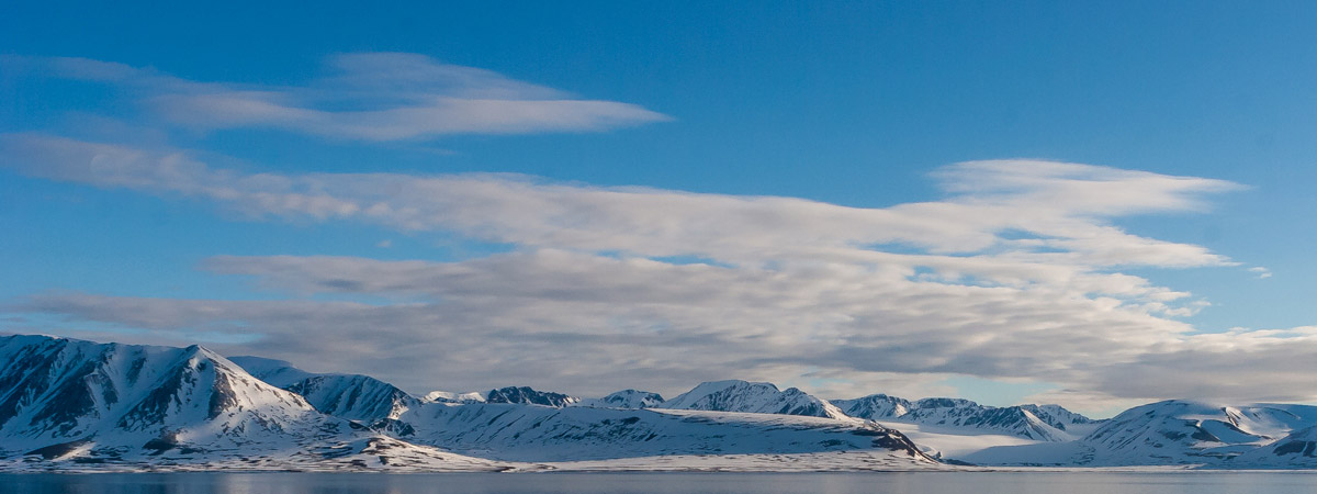 Distant view toward the Woodfjorden fjord in Svalbard, on a sunny day.